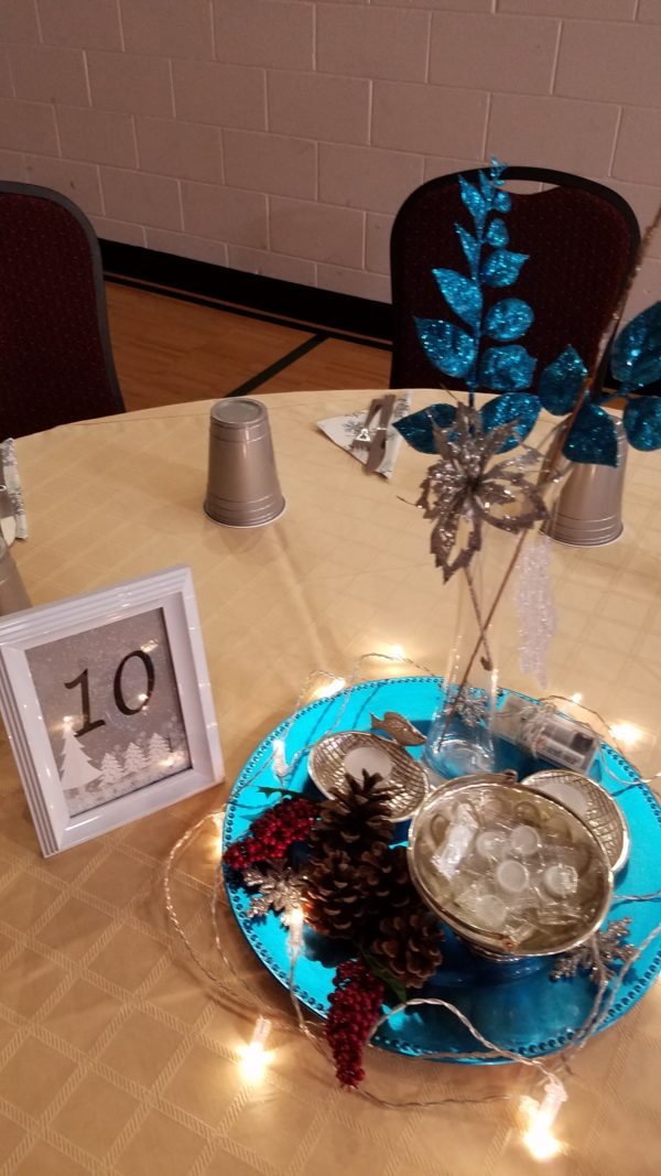 A light centerpiece used for the dance. Blue glitter leaves, some holiday festive objects