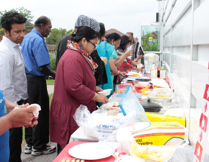 People grabbing and sharing food